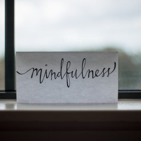 Card with the word Mindfulness, sitting on a windowsill