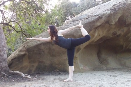 yoga instructor in dancer pose