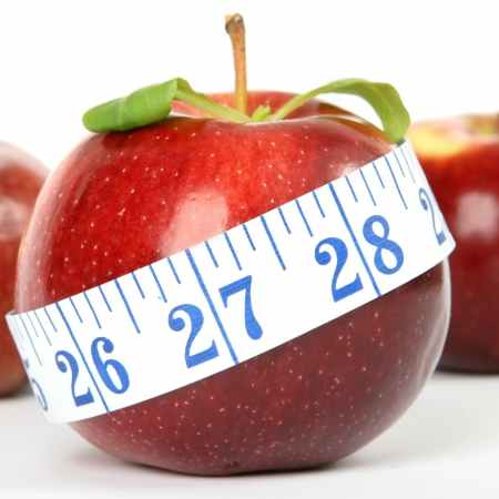 Apple with tape measure wrapped around